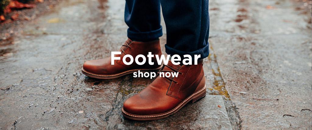 Wearing a Pair of Barbour Readhead Chukka Boots Colour Dark Brown.