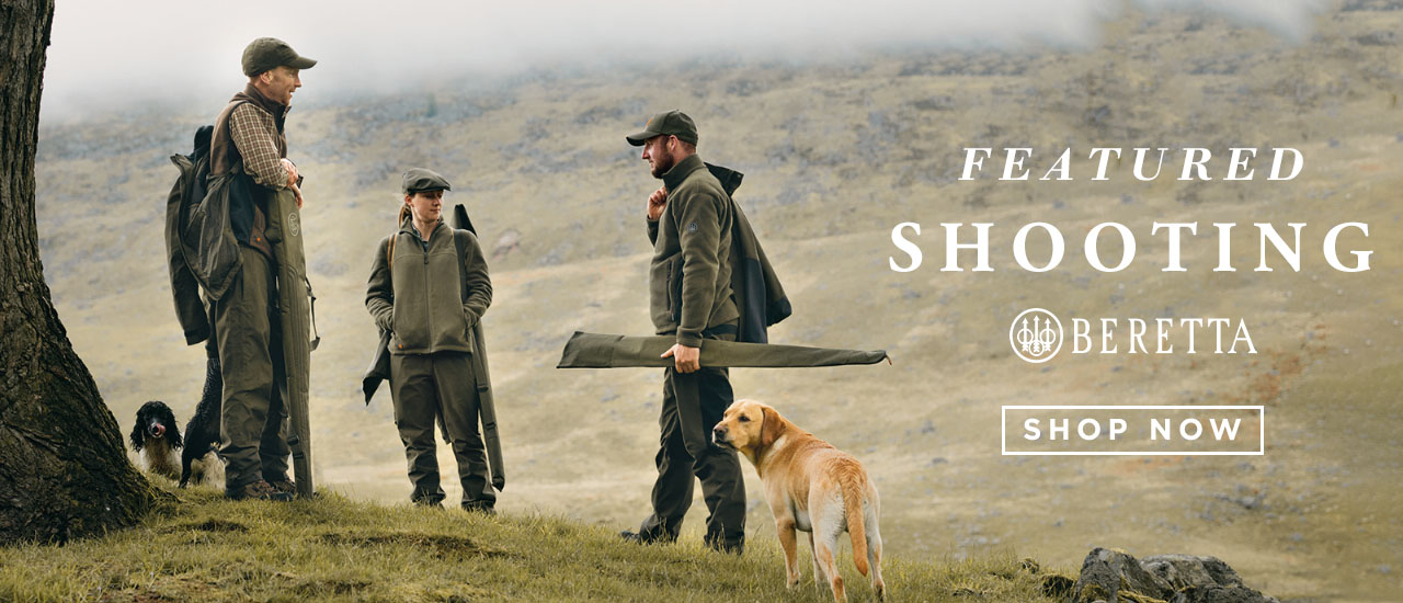 Men and Women Wearing Beretta Shooting Attire and Equipment With Hunting Dogs