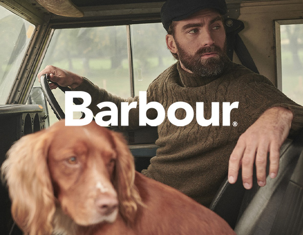 Man wearing Barbour Roll Neck Jumper and Flat Cap