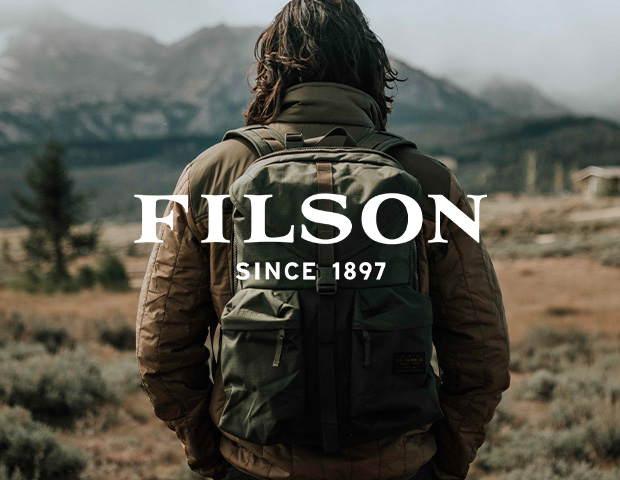Man wearing Filson Ultra Light Quilted Jacket and Ripstop Nylon Backpack