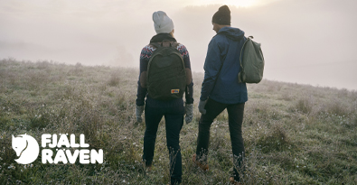 Couple Trekking Wearing Fjallraven Clothing and Backpacks