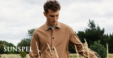 Man wearing Sunspel long sleeve button-up shirt