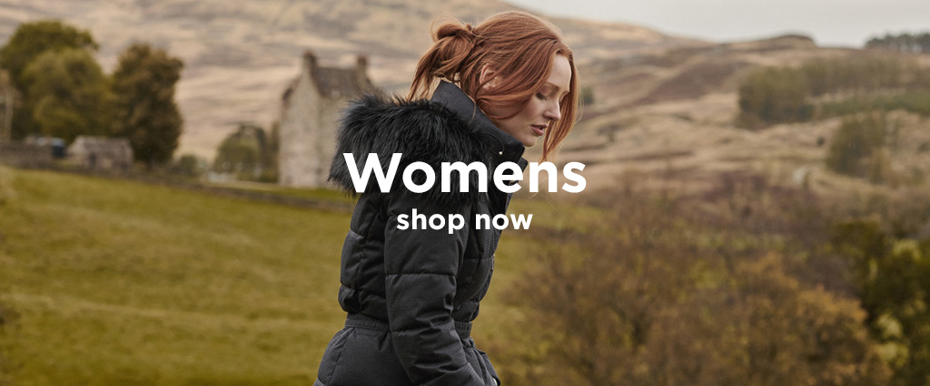 Woman Wearing Black Barbour Switun Quilted Jacket Walking Through The Countryside