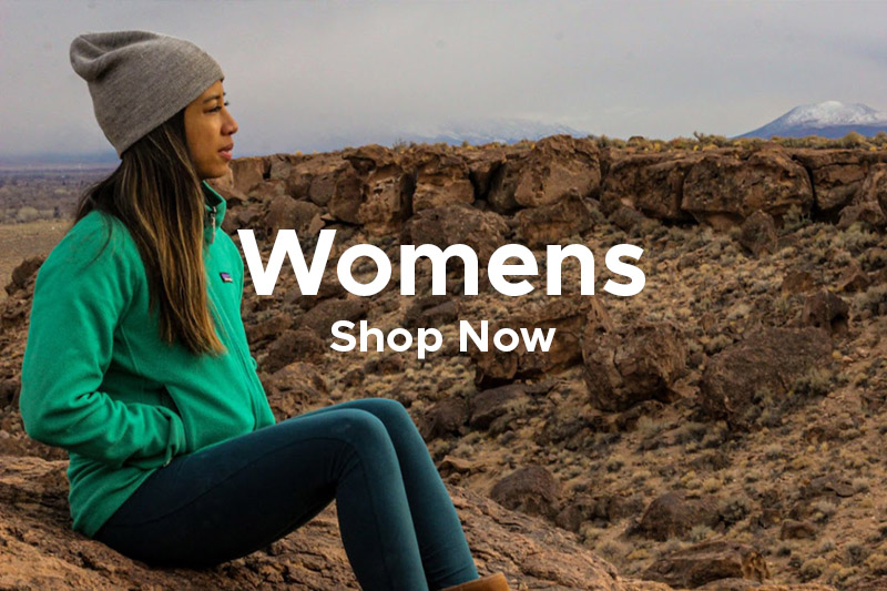 Woman Wearing Patagonia Outdoor Clothing sat in the Outback Wilderness