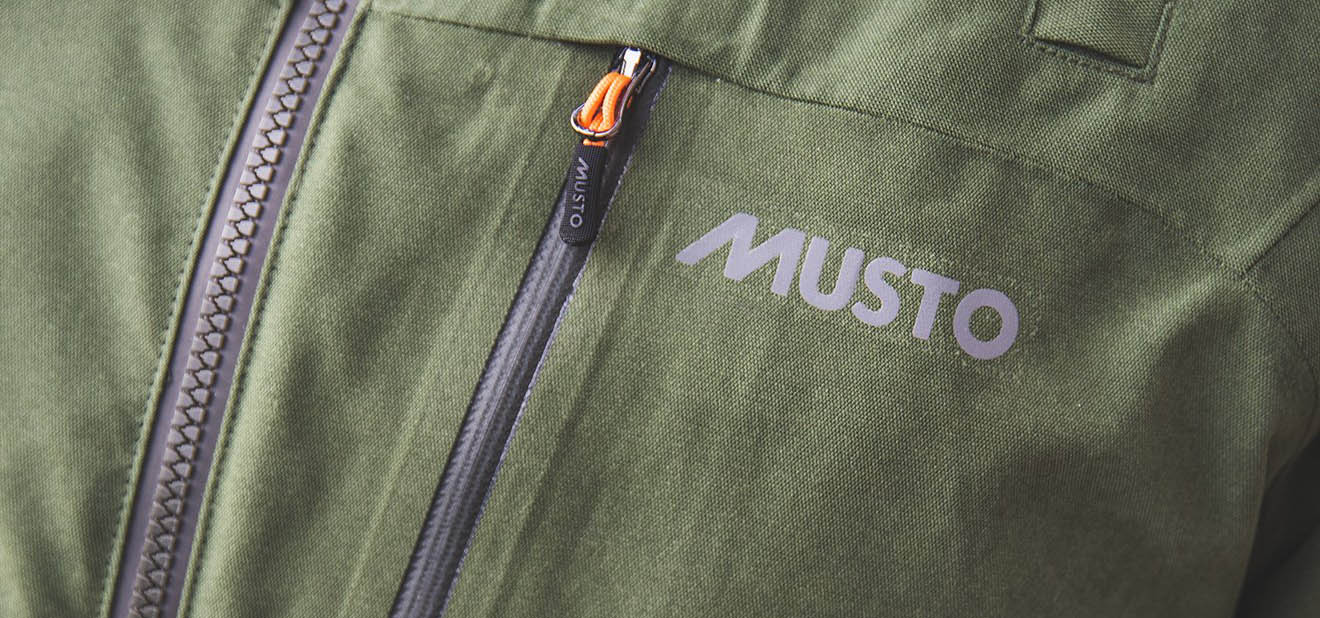 Logo on Musto HTX Keepers Jacket Colour Dark Moss