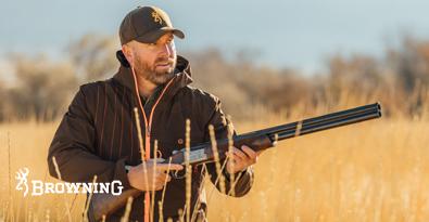 Hunter Wearing Browning Clothing, Jacket, hat and shotgun