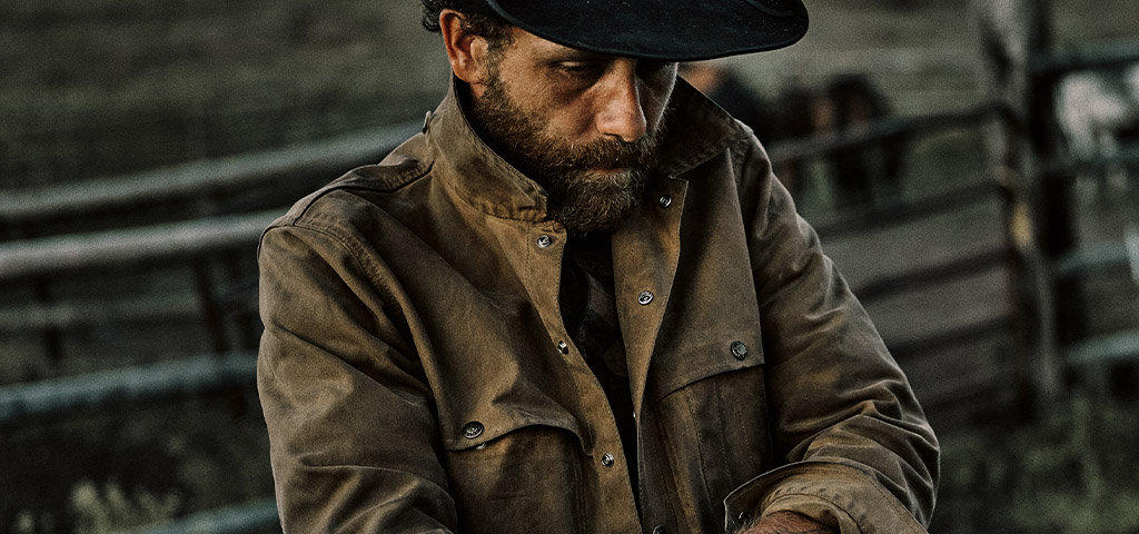 Man Wearing Filson Tin Cloth Olive Green Jacket & Tin Packer Hat
