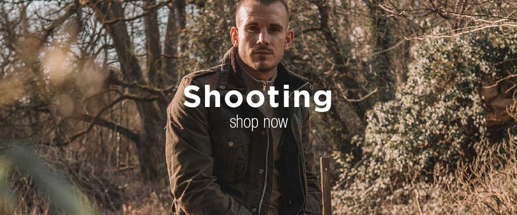 Man hunting wearing Barbour Olive Shooting Jacket