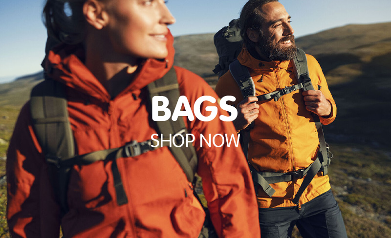 Man and Woman wearing Fjallraven Outdoor Clothing, weatherproof Jackets and travel backpacks.