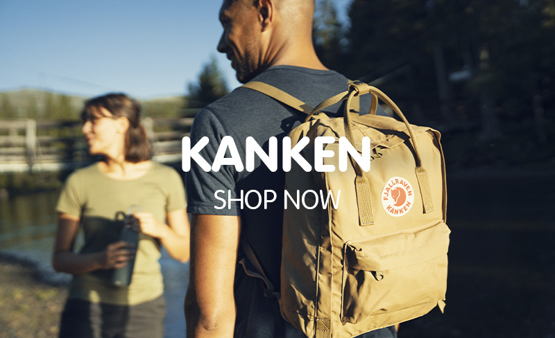 Couple Out Trekking, man wearing Fjallraven Kanken Classic Clay Backpack.