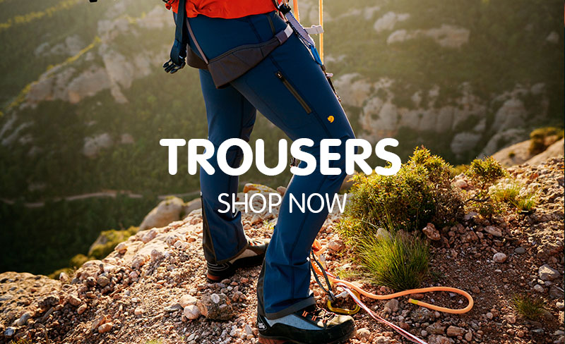 Climber ready to ascend mountain wearing navy blue Fjallraven trousers.