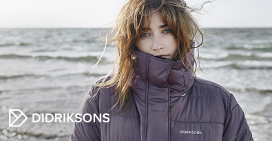 Women Wearing Didriksons Parka Jacket Standing By the Sea