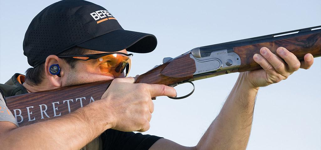 Competitor shooting Beretta Shotgun at Tokyo Olympic Event